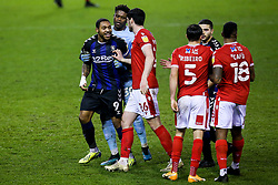 Britt Assombalonga of Middlesbrough is pulled away from Yuri Ribeiro of Nottingham Forest - Mandatory by-line: Robbie Stephenson/JMP - 20/01/2021 - FOOTBALL - City Ground - Nottingham, England - Nottingham Forest v Middlesbrough - Sky Bet Championship