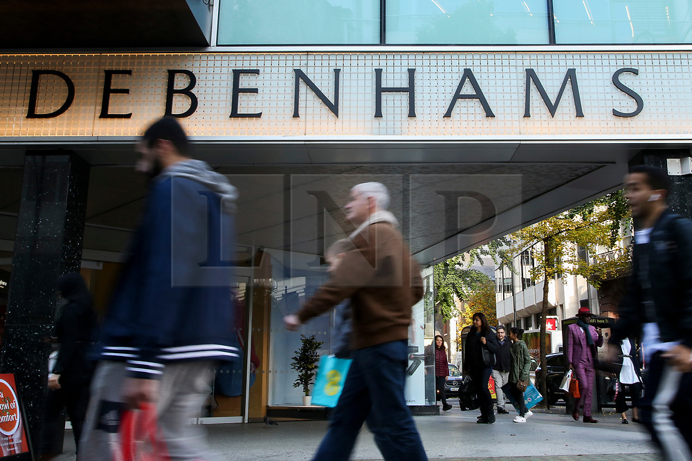 © Licensed to London News Pictures. 25/010/2018. London, UK. Shoppers walk past Debenhams on Oxford Street, London.<br /> Debenhams plans to close up to 50 stores, nearly a third of the UK-wide chain, putting up to 5,000 jobs at risk.<br /> The department store unveiled a near £500m annual loss as it writes off the value of its brand and the cost of unwanted shop leases and IT systems.  Photo credit: Dinendra Haria/LNP