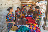 The final product consists of a variety of colorful clothing and home accesories which are packed and shipped to the United States for resale.  These remarkable women are involved in every step of the process including pricing conditions and production costs.