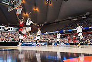 27 MAR 2015: Anthony 'Cat' Barber (12) of North Carolina State University goes for a layup in front of Terry Rozier (0) of the University of Louisville during the 2015 NCAA Men's Basketball Tournament held at the Carrier Dome in Syracuse, NY. Louisville defeated North Carolina State 75-65. Brett Wilhelm/NCAA Photos