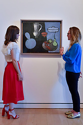 "© Licensed to London News Pictures. 01/08/2017. London, UK. Staff members view ""Gourds"", 1915-16.  Preview of ""Matisse in the Studio"", at the Royal Academy of Arts, Piccadilly, the first exhibition to consider how the personal collection of treasured objects of Henri Matisse were both subject matter and inspiration for his work.  Around 35 objects are displayed alongside 65 of Matisse's paintings, sculptures, drawings, prints and cut-outs.  The exhibition runs 5 August to 12 November 2017.  Photo credit : Stephen Chung/LNP"
