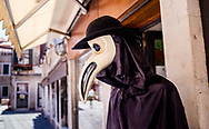 A shop display of a plague mask on the streets of Venice, Italy