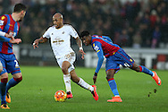 Andre Ayew of Swansea city breaks past Wilfied Zaha of Crystal Palace. Barclays Premier league match, Swansea city v Crystal Palace at the Liberty Stadium in Swansea, South Wales on Saturday 6th February 2016.<br /> pic by Andrew Orchard, Andrew Orchard sports photography.