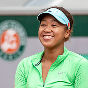 PARIS, FRANCE May 25. Naomi Osaka of Japan reacts during practice on CourtSimonne Mathieu in preparation for the 2021 French Open Tennis Tournament at Roland Garros on May 25th 2021 in Paris, France. (Photo by Tim Clayton/Corbis via Getty Images)