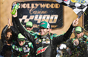 Chase Elliott celebrates winning a NASCAR Cup Series auto race at Kansas Speedway in Kansas City, Kan., Sunday, Oct 21, 2018. (AP Photo/Colin E. Braley)