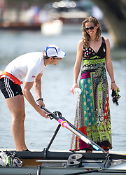 © London News Pictures. 05/07/2012.  Henley-on-Thames, UK. Katie Steenman on a pontoon with her partner Julian Bahain before he races on day three of Henley Royal Regatta on the River Thames at Henley-on-Thames, Oxfordshire on July 03, 2013. The 5 day regatta over the first weekend in July, races head-to-head knock out competitions over a course of 1 mile between rowing teams from throughout the world. Photo credit: Ben Cawthra/LNP