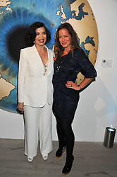 Left to right, BIANCA JAGGER and her daughter JADE JAGGER at Arts for Human Rights gala dinner in aid of The Bianca Jagger Human Rights Foundation in association with Swarovski held at Phillips de Pury & Company, Howick Place, London on 13th October 2011.