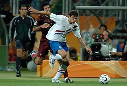 25-06-2006 VOETBAL: FIFA WORLD CUP: NEDERLAND - PORTUGAL: NURNBERG<br /> Oranje verliest in een beladen duel met 1-0 van Portugal en is uitgeschakeld / BOULAHROUZ Khalid krijgt de rode kaart voor een elleboog duikeling van LUIS FIGO <br /> ©2006-WWW.FOTOHOOGENDOORN.NL