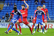 Cardiff City's Bruno Ecuele Manga (blue) is challenged by Blackburn Rover's Grant Hanley (c). Skybet football league championship match, Cardiff city v Blackburn Rovers at the Cardiff city stadium in Cardiff, South Wales on Saturday 2nd Jan 2016.<br /> pic by Carl Robertson, Andrew Orchard sports photography.