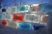 Father spends six nights in -30C weather to build his own rainbow ICE FORT from hundreds of frozen plastic shoeboxes<br /> <br /> Temperatures in north-western Ontario averaged at -25 degree Celsius or colder throughout  December 2013<br /> <br /> Chris Marchand froze hundreds of ice blocks in 8-litre plastic shoeboxs and filled them with food colouring<br /> <br /> It took six nights working at -30 degree Celsius to erect the colorful wall<br /> <br /> As temperatures dropped to -30 degree Celsius, residents of Ontario could be forgiven for rejecting the great outdoors in favour of keeping warm inside.<br /> <br /> But one father refused to be deterred by the bitter temperatures and found an ingenious way to pass the long winter hours of sub-zero temperatures by creating a colorful ice fort in his backyard. <br /> <br /> Chris Marchand filled hundreds of eight-litre plastic shoeboxes with water and food colouring - he filled about 30 each day. <br /> He stored them in his driveway for a month until he had created enough to create his vision.<br /> <br /> Mr Marchand then set about building the boundary of a 25′ x 25′ fort - it took him six nights work at -30 degree Celsius to erect the wall.<br /> <br /> When the work was complete he invited over his friends and family to enjoy a night in his creation, as he sat back and admired his vision as king of his castle. <br /> <br /> Mr Marchand explains: 'Sidelined from my usual outdoor pursuits by the cold, I started freezing blocks of ice on my deck for the hell of it.<br /> 'I found a certain kind of shoebox size plastic container that could handle the expansion and would release the frozen blocks easily and consistently without having to use hot water. <br /> <br /> 'Mass production began at 30 blocks per day - a new harvest every 12 hours. It was huge pain in the a** after a while. <br /> <br /> 'I marked off a 25' x 25' space and started building my wall on a 1 foot pony wall of snow that i compacted using plywood s