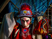 26 AUGUST 2018 - GEORGE TOWN, PENANG, MALAYSIA: A performer puts on his hat before a Hokkien style Chinese opera on the Lim Jetty in George Town for the Hungry Ghost Festival. The opera troupe came to George Town from Fujian province in China. The Hungry Ghost Festival is a traditional Buddhist and Taoist festival held in Chinese communities throughout Asia. The Ghost Festival, also called Ghost Day, is on the 15th night of the seventh month (25 August in 2018). During the Hungry Ghost Festival, the deceased are believed to visit the living. In many Chinese communities, there are Chinese operas and puppet shows and elaborate banquets are staged to appease the ghosts.     PHOTO BY JACK KURTZ