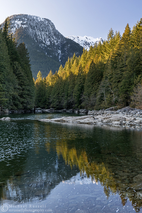 Reflection of Evans Peak in Gold Creek at North Beach on Alouette Lake.  Photographed at Golden Ears Provincial Park in Maple Ridge, British Columbia, Canada