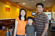 Owner Kevin Tran poses with his wife, May Tran, and son, Jadon Tran, in the dining room of Pho Saigon Noodle House in Milpitas, Calif., on Sept. 19, 2012.  Pho Saigon Noodle House was awarded Milpitas' Best Bowl of Pho for 2012.  Photo by Stan Olszewski/SOSKIphoto.