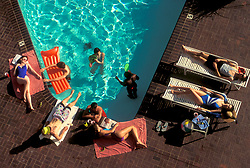 Stock photo of relaxing by the pool on a warm summer's day.