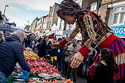 The puppet known as Little Amal continues her 8,000km journey from Turkey, across Europe, through Deptford market in South London and on to other UK cities, on 22nd October 2021, in London, England. 'Little Amal' is a 3.5 metre high character who represents a refugee girl fleeing conflict.