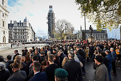 © Licensed to London News Pictures. 11/11/2018. LONDON, UK.  Thousands of people stand during the two minute silence in Parliament Square on Remembrance Sunday which, this year, marks the centenary of Armistice Day.  Big Ben, the bell inside the Elizabeth Tower, currently undergoing renovation, has been given a special makeover in order to chime at 11am.  Photo credit: Stephen Chung/LNP