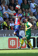 Jordan Mutch out jumps Tony Andreu during the Barclays Premier League match between Norwich City and Crystal Palace at Carrow Road, Norwich, England on 8 August 2015. Photo by Craig McAllister.