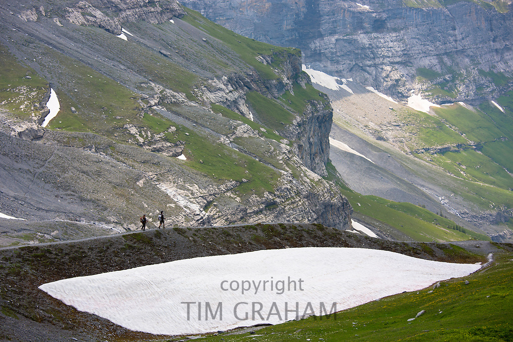 Hikers on the Eiger Trail in Swiss Alps, Bernese Oberland, Switzerland