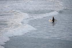 May 6, 2019 - Christchurch, New Zealand - A surfer walks into the water at New Brighton Beach in Christchurch, New Zealand on May 05, 2019. (Credit Image: © Sanka Vidanagama/NurPhoto via ZUMA Press)