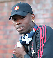 Manchester United's Paul Pogba gets off the train at Wilmslow Station after his sides defeat to West Ham United