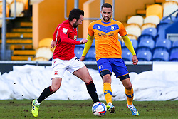 Aaron Wildig of Morecambe chases down Jordan Bowery of Mansfield Town - Mandatory by-line: Ryan Crockett/JMP - 27/02/2021 - FOOTBALL - One Call Stadium - Mansfield, England - Mansfield Town v Morecambe - Sky Bet League Two