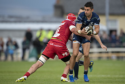 September 22, 2018 - Galway, Ireland - Tiernan O'Halloran of Connacht tackled by Blade Thomson of Scarlets during the Guinness PRO14 match between Connacht Rugby and Scarlets at the Sportsground in Galway, Ireland on September 22, 2018  (Credit Image: © Andrew Surma/NurPhoto/ZUMA Press)