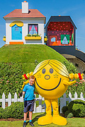 Sam (aged 10, a cancer survivor) and Ross (8) Sharland with Little Miss Sunshine on The Children with Cancer UK: Mr Happy and Mr Worry Hill garden by Emma reid - Press day at The RHS Hampton Court Flower Show.