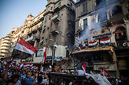 Anti government demonstrators light fireworks after hearing of president Morsi's arrest by the military. Tahrir Square, Cairo, Egypt