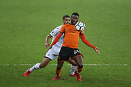 Bright Enobakhare of Wolverhampton Wanderers shields the ball from Kyle Naughton of Swansea city.  The Emirates FA Cup, 3rd round replay match, Swansea city v Wolverhampton Wanderers at the Liberty Stadium in Swansea, South Wales on Wednesday 17th January 2018.<br /> pic by  Andrew Orchard, Andrew Orchard sports photography.