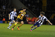 Hull city's George Boyd © looks to go past West Brom's Billy Jones. Barclays Premier league, West Bromwich Albion v Hull city at the Hawthorns in West Bromwich, England on Saturday 21st Dec 2013. pic by Andrew Orchard, Andrew Orchard sports photography.