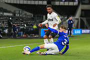 Nathan Byrne of Derby County (12) is tackled by Cardiff City defender Joe Bennett (3)  during the EFL Sky Bet Championship match between Derby County and Cardiff City at the Pride Park, Derby, England on 28 October 2020.
