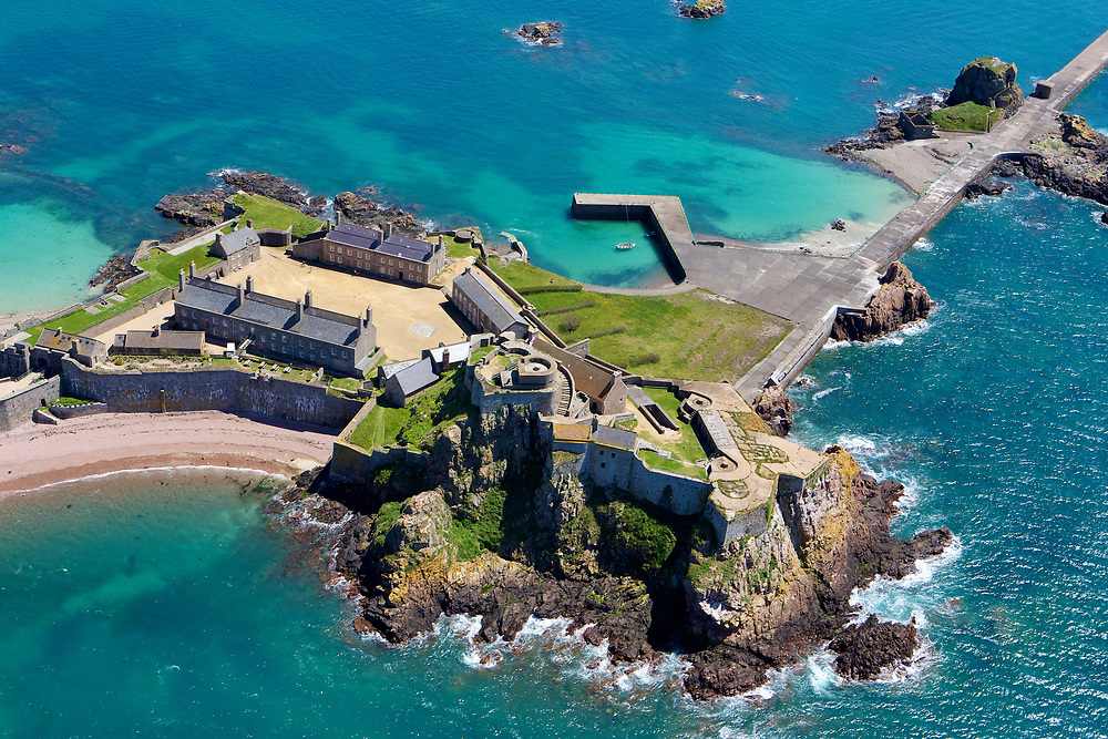 Aerial View of the Heritage site and tourist attraction Elizabeth Castle and its beach with crystal clear turquoise water in Jersey, Channel Islands