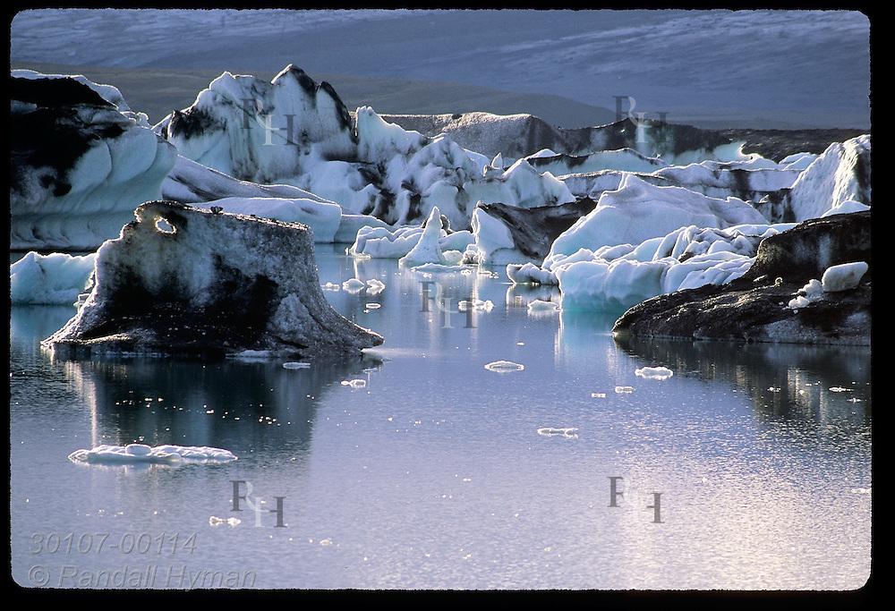 Ice that has calved from Breidamerkurjokull glacier floats slowly to sea in coastal Jokulsarlon (Glacier Lagoon); southeast Iceland.