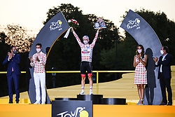 UAE Emirates's rider Tadej Pogacar winner of the polka dot jersey and overall winner on the podium of the Tour de France 2020, on Champs Elysees Avenue in Paris, on September 20, 2020. / Sportida