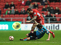 Fleetwood Town's Bobby Grant is fouled by Bristol City's Lee Tomlin<br /> <br /> Photographer Ashley Crowden/CameraSport<br /> <br /> Emirates FA Cup Third Round - Bristol City v Fleetwood Town - Saturday 7th January 2017 - Ashton Gate - Bristol<br />  <br /> World Copyright © 2017 CameraSport. All rights reserved. 43 Linden Ave. Countesthorpe. Leicester. England. LE8 5PG - Tel: +44 (0) 116 277 4147 - admin@camerasport.com - www.camerasport.com