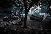 Burn cars sit in front of a home in Calistoga on Monday, Sept. 28, 2020.