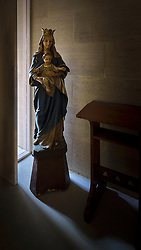 As I was preparing to lock up and leave the Ripon College Chapel, this madonna statue caught my eye, standing in the late evening light from a window. With the interior lights turned off the extreme backlighting made a beautiful play, but was quite difficult to capture.<br /> <br /> Bishop Edward King Chapel, Ripon College
