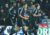Photo: Paul Greenwood.<br />Wigan Athletic v Chelsea. The Barclays Premiership. 23/12/2006. Chelsea's Frank Lampard, centre, clenches his fist in celebration at scoring the opening goal