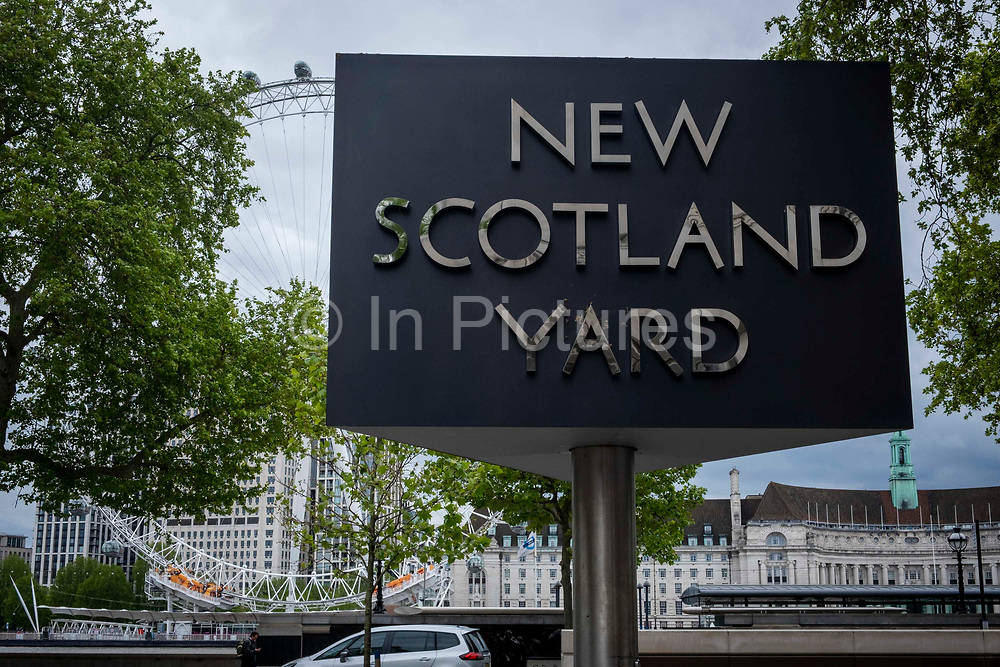 The New Scotland Yard sign and building, the headquarters of the the Metropolitan Police, the police force responsible for policing the boroughs of London on the 25th of May 2021, Westminster, London, United Kingdom.