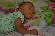 An eight months old baby sleeps in a hotel room in Mariana that is housing displaced people by a flood. On november 5th, a mining waste dam failed causing a flood of mud over Bento Rodrigues, a district of the city of Mariana, in the brazilian state of Minas Gerais.
