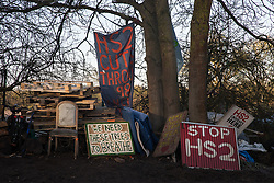 Harefield, UK. 18 January, 2020. The Stop HS2 Colne Valley camp is pictured on the second day of a three-day 'Stand for the Trees' protest in the Colne Valley organised by Extinction Rebellion, Stop HS2 and Save The Colne Valley to coincide with tree felling work by HS2 in the area. Bailiffs acting for HS2 have been evicting Stop HS2 activists from the camp for the past week and a half. 108 ancient woodlands are set to be destroyed by the high-speed rail link.
