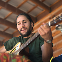 """Emmanuel Quezada sings one of his original songs """"My Passion,"""" Wednesday at the farmers market in Candy Kitchen."""