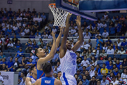 November 27, 2017 - Cubao, Quezon City, Philippines - Quincy Spencer Davis III scored a basket against Japeth Aguilar. Davis III scored a total of 20 points in 8 out of 12 field goals.Gilas Pilipinas defended their home against Chinese Taipei. Game ended at 90 - 83. (Credit Image: © Noel Jose Tonido/Pacific Press via ZUMA Wire)