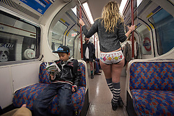 © licensed to London News Pictures. London, UK 13/01/2013. Over 100 people take part in the 4th annual No Trousers Underground day on the London Underground on Sunday January 13, 2013. Participants  travel on the underground without trousers as part of a global Improve Everywhere event which started in New York 11 years ago. Photo credit : Tolga Akmen/LNP