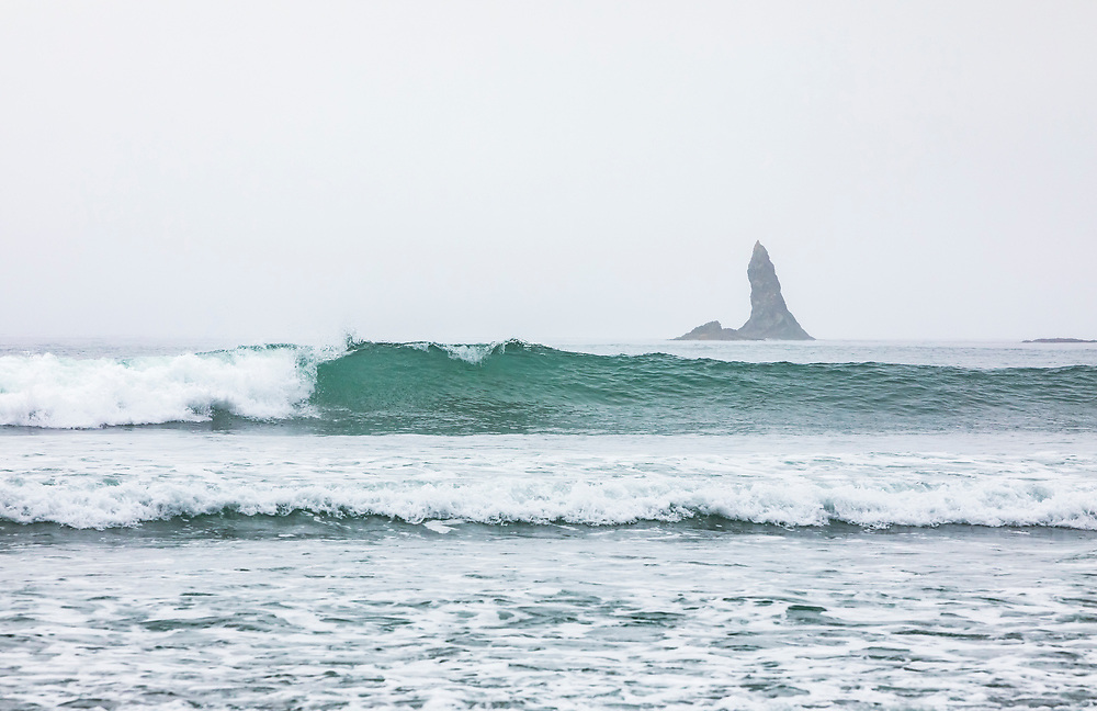 A breaking wave and a pointy offshore rock spire, 2nd Beach, Olympic National Park Coastal Preserve.