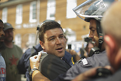 August 13, 2017 - Charlottesville, Virginia, United States - JASON KESSLER was forcibly removed by State Police. Jason Kessler, one of the main organizers for the Unite The Right Rally held this weekend in Charlottesville, attempted to hold a press conference to counter the events of Saturday. The Presser last about 3 minutes before Kessler was chased and beaten. He was evacuated by Virginia State Police. (Credit Image: © Shay Horse/NurPhoto via ZUMA Press)