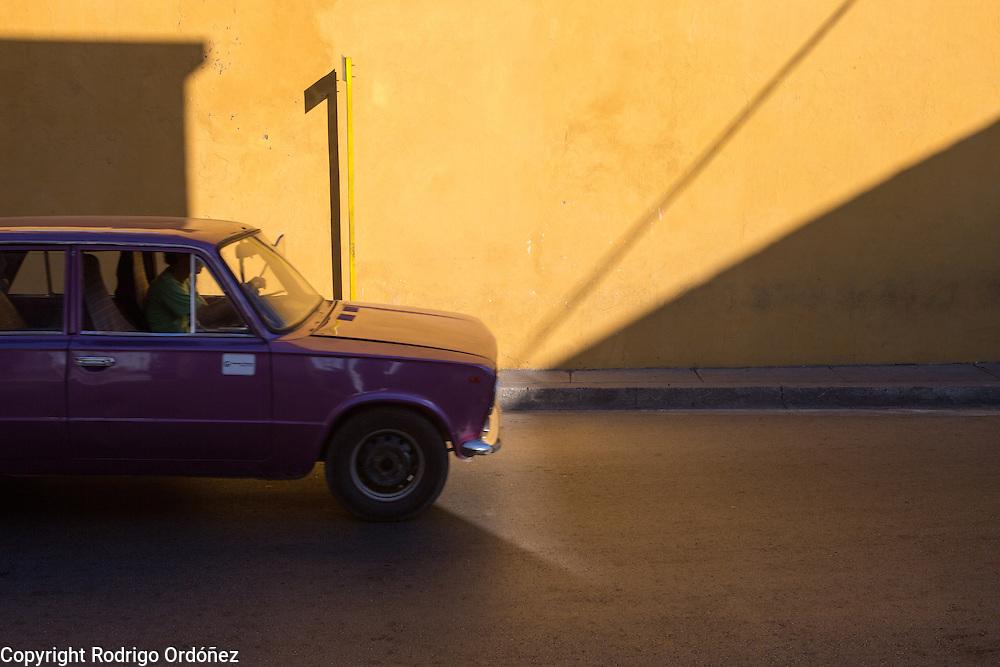 A car drives through the streets of Santiago de Cuba, Cuba, on December 25, 2014.