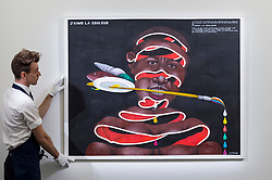 "© Licensed to London News Pictures. 29/03/2019. LONDON, UK. A technician presents ""J'aime la couleur"", 2005, by Chéri Samba (Est. GBP 40,000-60,000). Preview of Sotheby's upcoming Modern and Contemporary African Art sale.  Works from artists across the African diaspora will be offered for sale on 2 April.  Photo credit: Stephen Chung/LNP"
