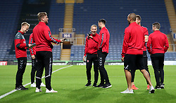 Charlton Athletic players inspect the pitch prior to kick off at the Kassam Stadium