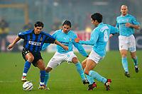Rome December 7 2002 - Italian Championship<br />Lazio - Inter 3-3<br />Sergio Conceicao, Inter, challenged from Stefano Fiore and Bernardo Corradi Lazio